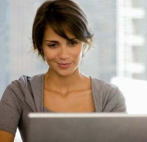 A woman using a computer.