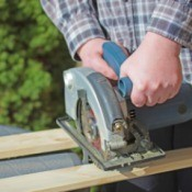 A man using a circular saw.