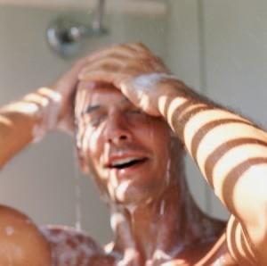 A man applying coal tar shampoo.