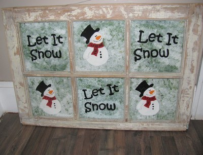 Six pane window with snowmen and lettering.