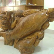 Wooden table base with fish and other details.