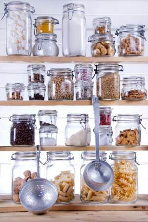 Stored food in a jars in a pantry.