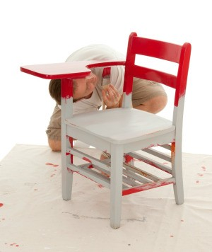 Painting a wood chair.