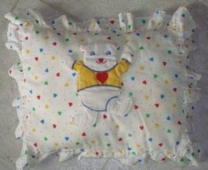 baby pillow with bear motif