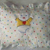 baby pillow with bear motif