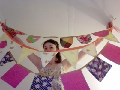 three strings of fabric banner