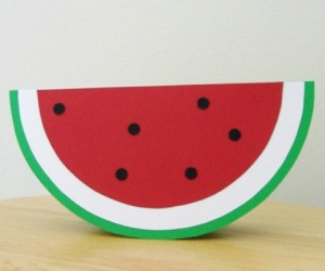 A greeting card showing a semi circular slice of watermelon.