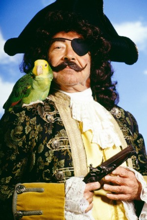 Man Dressed as Pirate with Parrot on Shoulder