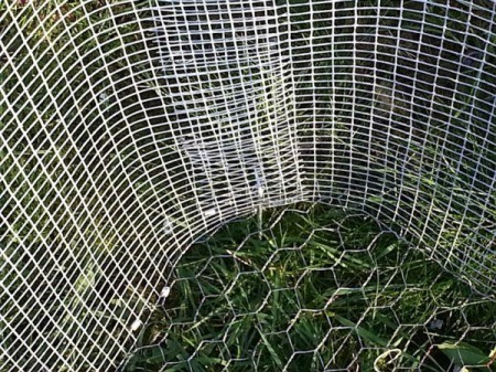 view of cage with attached chicken wire bottom
