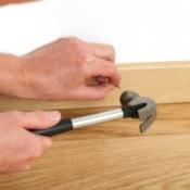 Man Installing Baseboard Moldings
