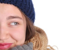 Girl wearing a knitted hat.