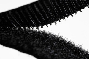 black Velcro being pulled apart