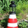 clay pot lighthouse in garden