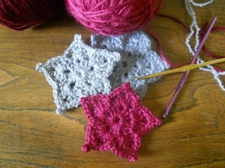 three stars with yarn and hooks