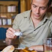 Man Using Salt Substitute