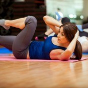 Woman Exercising Abdominal Muscles