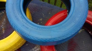 blue, red, and yellow stacked tires