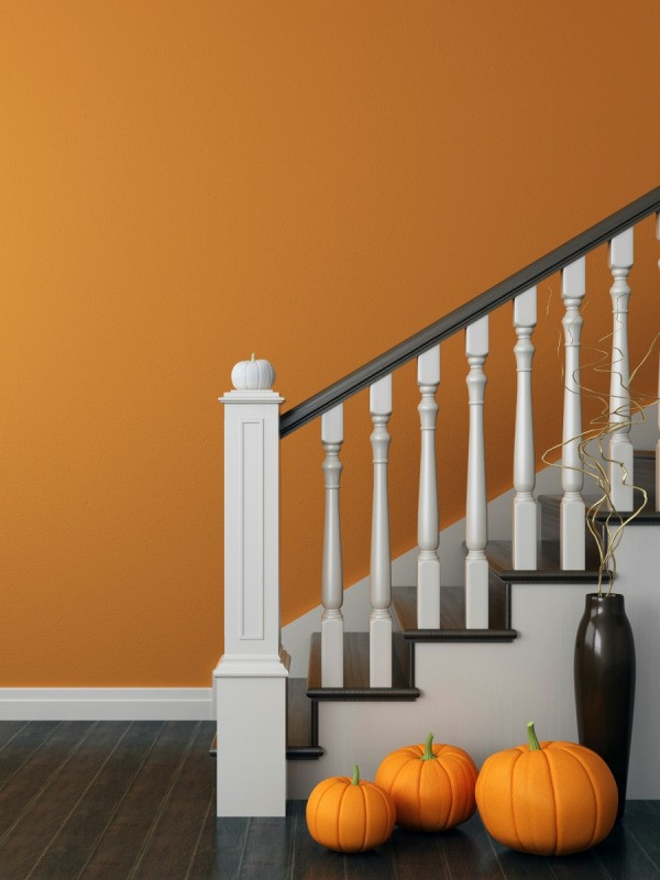 A Staircase Next To An Orange Painted Wall.