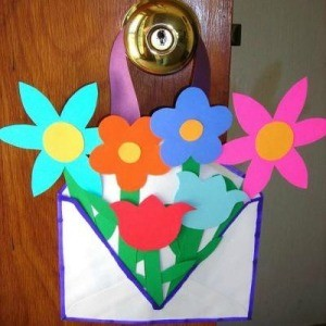envelope filled with paper flowers
