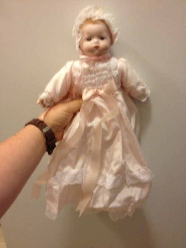 doll in long pink dress with bonnet