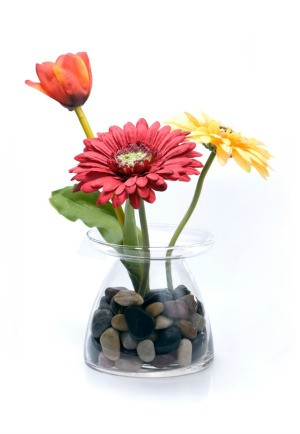 silk flowers in a glass vase