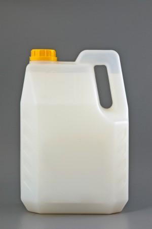 transparent container of liquid laundry detergent