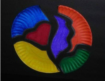 paper plate painted different colors and cut into puzzle
