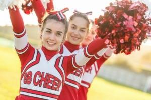 cheerleaders holding up pons