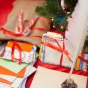 bundles of Christmas letters with quill pen and ink pot