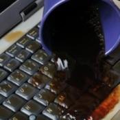 dark liquid spilled on laptop keyboard