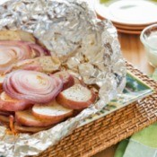 grilled potatoes and onions in foil package