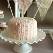 cake banner on pink frosted cake