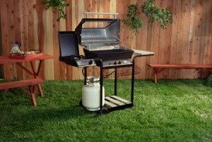propane tank attached to backyard barbecue