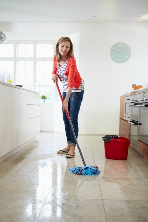 Woman Cleaning Her Floor