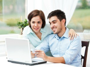 Couple Using Online Savings Institution