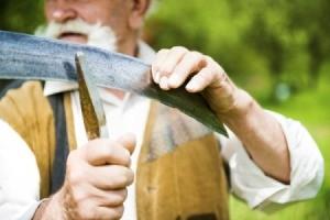 Man Sharpening a Scythe