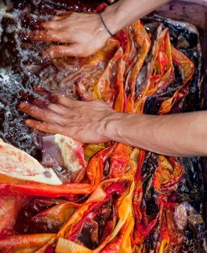 hands of someone dyeing cloth