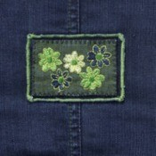 stitched flowers on jeans patch