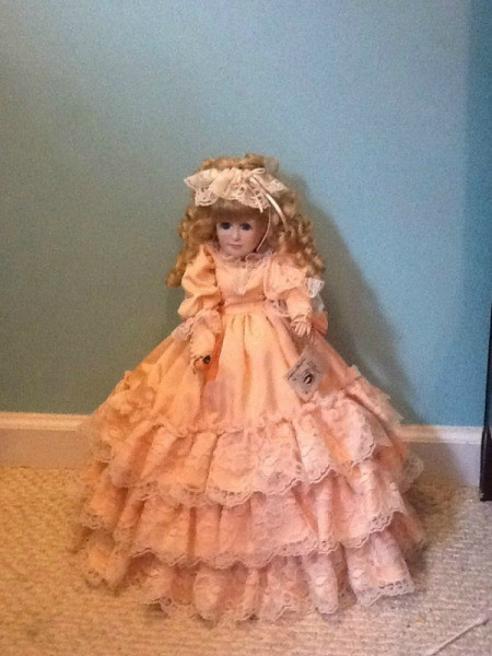 doll in long peach colored dress