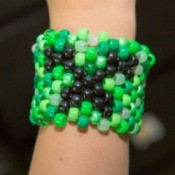 Beaded Minecraft Creeper Cuff - finished bracelet being worn