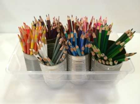 pencils separated by color in tin cans