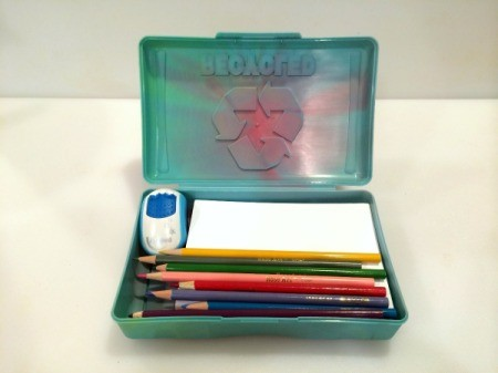 green plastic box with drawing supplies