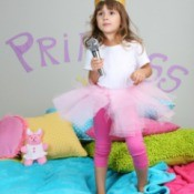 little girl dancing on bed in princess room