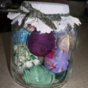 glass jar with rolled balls of fabric