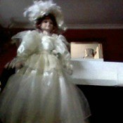 doll in fancy white dress with large hat