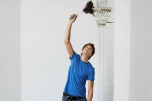 Man Cleaning a Vintage Chandelier