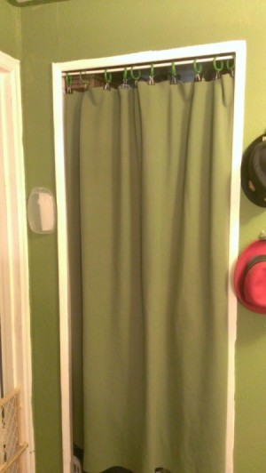 Blanket Curtain in a doorway hung with binder clips and shower curtain rings Without Sewing