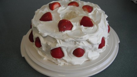 Gluten Free Strawberry Delight - Cake with frosting and strawberries.