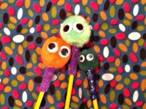 three decorated pencils