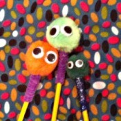 three decorated pencils
